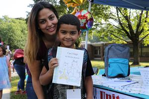 A Woodside student selects a free book to take home